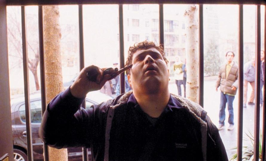 Hossain Emadeddin in Jafar Panahi's Crimson Gold