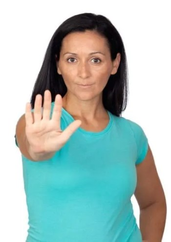 Woman exprssing the will power to say no to junk food and chemical sensitivities