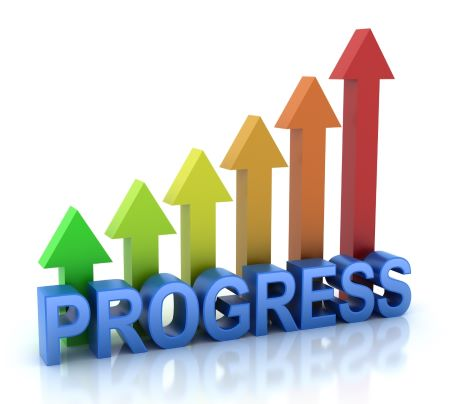 "Graphic. The word ""Progress"" in blue, with arrows pointing up, ranging from short green arrow on left to tall red arrow on right."
