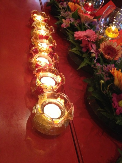 Little candles with the flower offerings