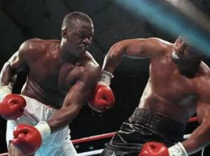 """Columbus, Ohio's James """"Buster"""" Douglas crushing blow sends Mike Tyson on his way to the canvas, in the greatest boxing upset of all time."""