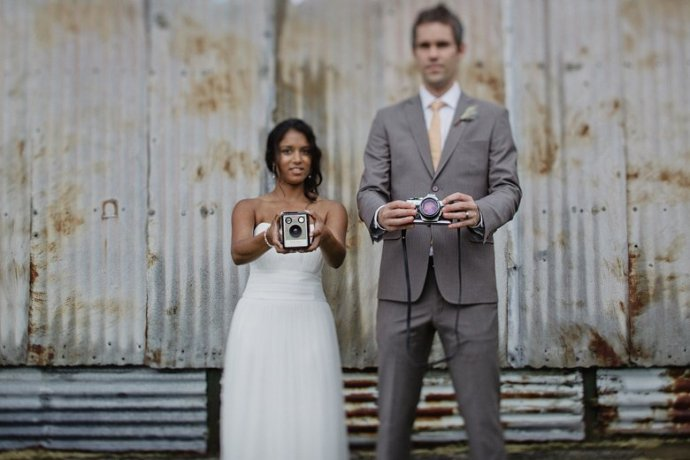 formal shot, with cameras