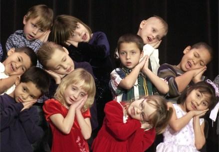 Grant School kindergardners sing songs during their school Christmas program in Norfolk Tuesday evening, Dec. 16, 2003.