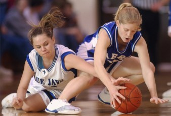 Ashley Schuetze (left) of West Point Central Catholic, left, and Michelle Weinrich of Pierce battle for control of a loose ball during action Saturday night, Feb. 8, 2003.