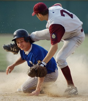 Marcus Manganaro (7) of Wakefield collides with Mitchell Happ of Palmer-Wolbach-Greeley while trying to make a throw to first for a double-play Tuesday, August 6, 2002.