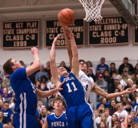 DARIN EPPERLY/DAILY NEWS -- NORFOLK -- Jack Charlson and Dalton Tremayne (11) of Ponca and D'Von LaPointe of Winnebago reach for a rebound during the Lewis & Clark Conference championship game on Monday night in Laurel. 2-6-17