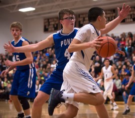 DARIN EPPERLY/DAILY NEWS -- NORFOLK -- Manape Cleveland of Winnebago makes a move to get past Carter Kingsbury of Ponca during the Lewis & Clark Conference championship game on Monday night in Laurel. 2-6-17