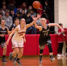 DARIN EPPERLY/DAILY NEWS -- O'NEILL -- Hattie Blumenstock of O'Neill St. Mary's and Kelsey Reiman of Boyd County chase down a loose ball during Tuesday night's game in O'Neill. 2-7-17
