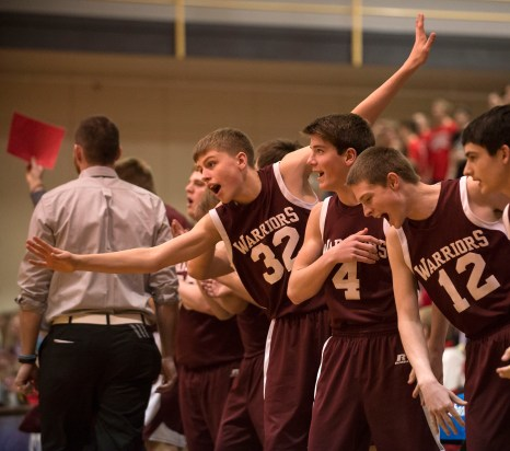 DARIN EPPERLY/DAILY NEWS LINCOLN -- Neligh-Oakdale's bench, including Isiac Kurpgeweit (32), Cole Belitz (4) and Logan McConnell (12), celebrate a three pointer during their first round game against Amherst at the Lincoln Southeast in Lincoln on Thursday afternoon. 3-9-17