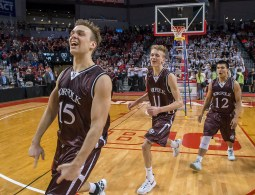 DARIN EPPERLY/DAILY NEWS LINCOLN -- Lane McCallum (15), Tate Werner (11) and Jordan James of Norfolk celebrate their win over Papillion-LaVista after the Class A championship game on Saturday night at Pinnacle Bank Arena. 3-11-17