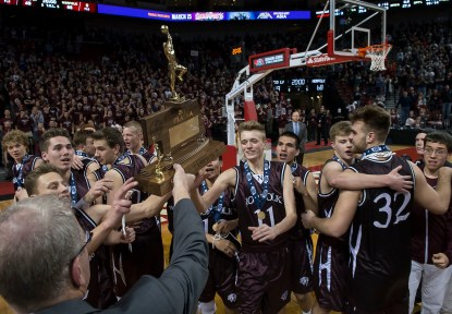 DARIN EPPERLY/DAILY NEWS LINCOLN -- The Class A championship trophy is presented to the Norfolk Panthers after the game on Saturday night at Pinnacle Bank Arena. 3-11-17