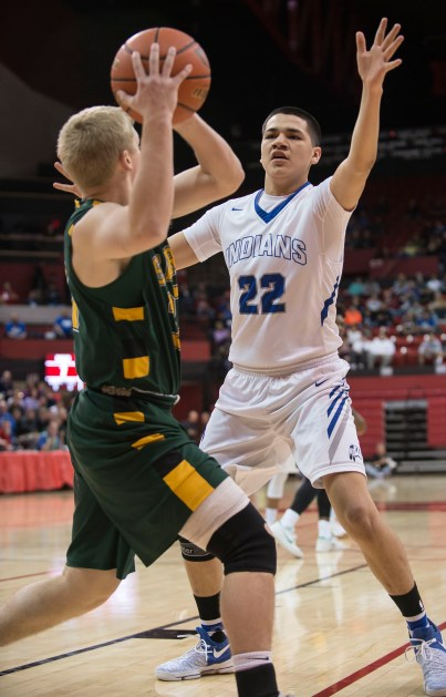 DARIN EPPERLY/DAILY NEWS LINCOLN -- MaNaPe Cleveland of Winnebago guards Cam Moore of Kearney Catholic during their first round game at the Devaney Sports Center on Thursday morning in Lincoln. 3-9-17