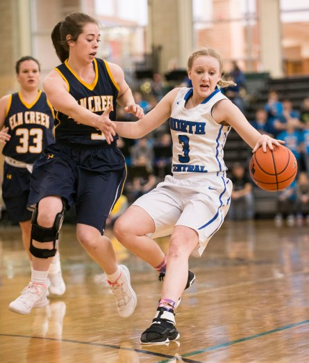 DARIN EPPERLY/DAILY NEWS LINCOLN -- Jadyn Bussinger of North Central is fouled by Madison Bourbon of Elm Creek during their first round Class D1 game at Lincoln Southwest on Thursday. 3-2-17