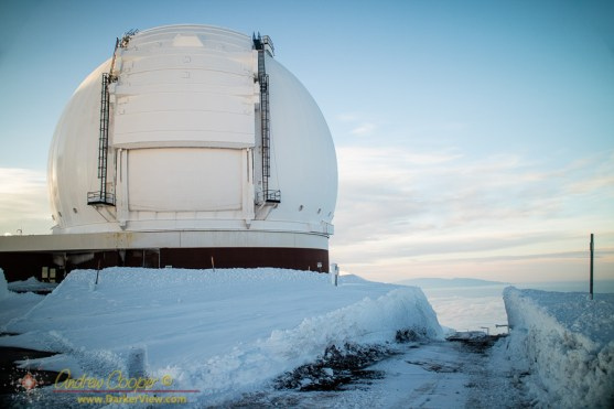 Deep drifts in front of Keck Observatory cut through by the MKSS snowplow crews