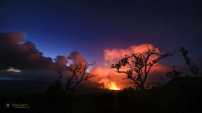 The glow from a lava lake in Halemaʻumaʻu lights the clouds prior to the May 2018 eruptions