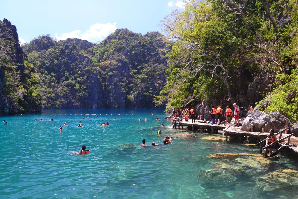 View of swimmers in Kayangan Lake