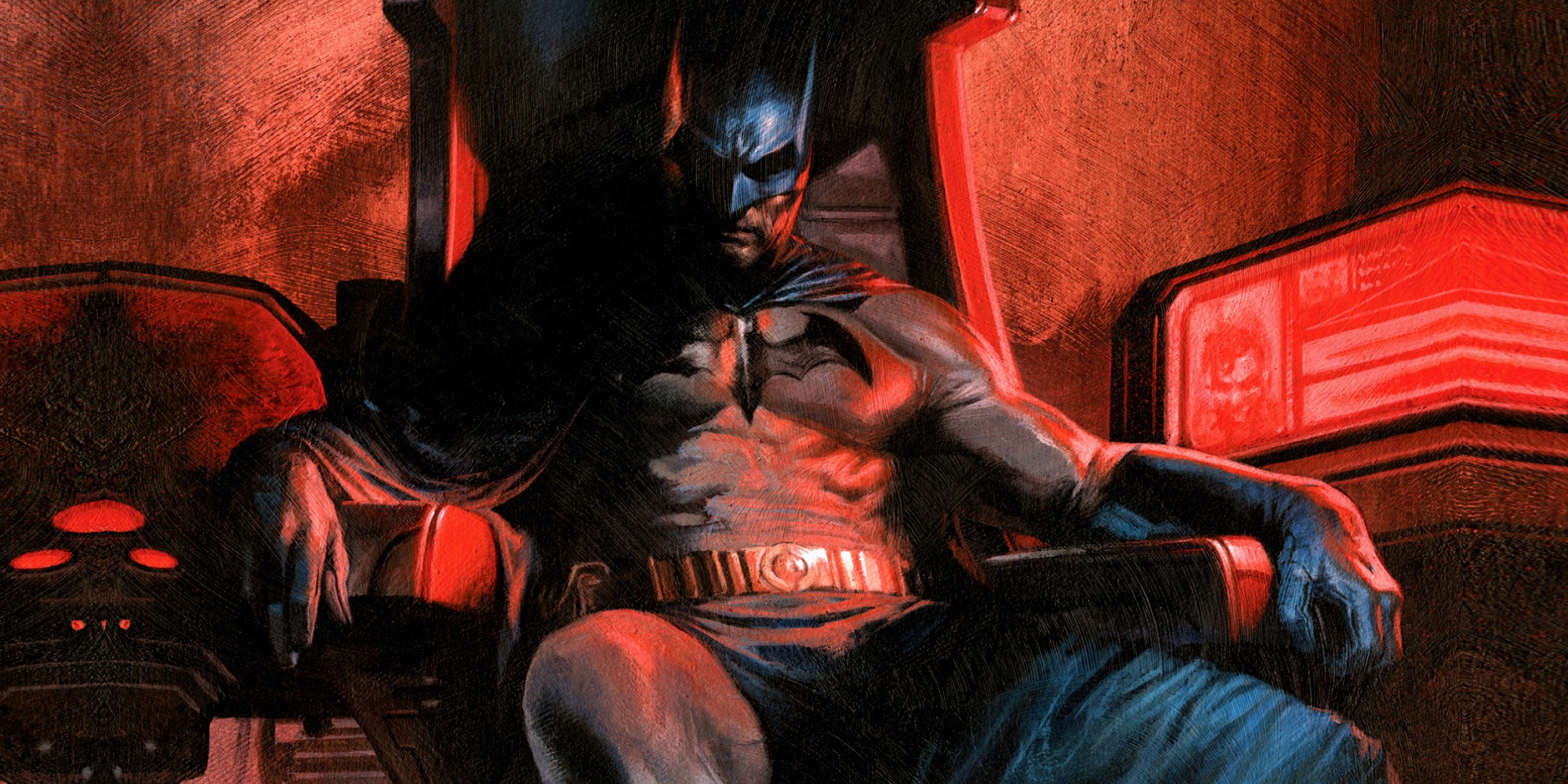Batman sitting in a chair, lit by red lights.