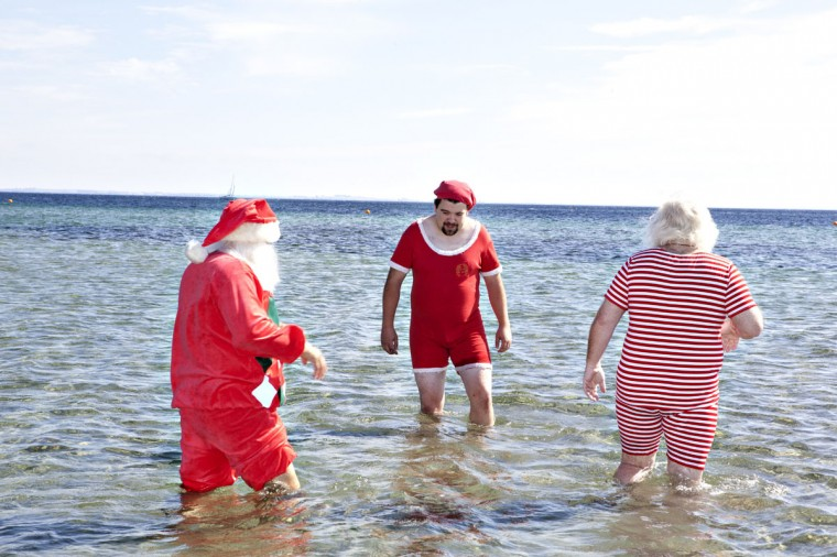 Santas from all parts of the world take part in the traditional foot bath on July 23, 2012 at Bellevue Beach north of Copenhagen. The bath marks the beginning of the annual World Santa Claus Congress, which ran through July 26, 2012. (Casper Christoffersen/AFP/GettyImages)