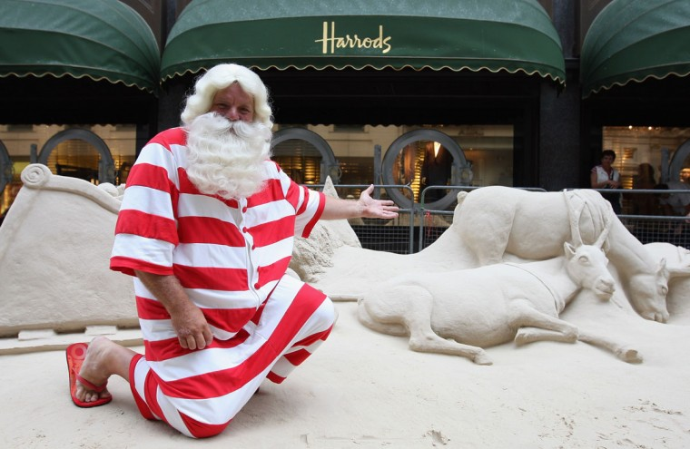 Santa Claus stands next to a sand sculpture outside Harrods Department Store to promote the new Christmas section on August 05, 2008 in London, England. (Dan Kitwood/Getty Images)