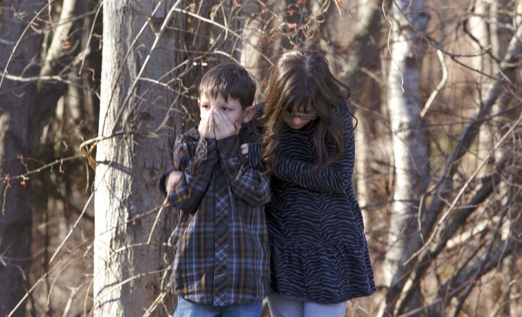 Young children wait outside Sandy Hook Elementary School after a shooting in Newtown, Connecticut. A shooter opened fire at the elementary school in Newtown, Connecticut, on Friday, killing several people including children, the Hartford Courant newspaper reported. (Michelle McLoughlin/Reuters photo)