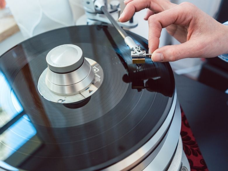 Record Player Setup Guide how to set up a record player placing needle on record player
