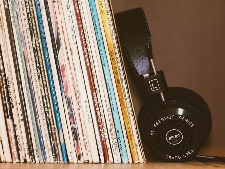 headphones leaning against warped records