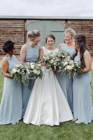 Grey bridesmaids dresses and white and green Darling Buds flowers