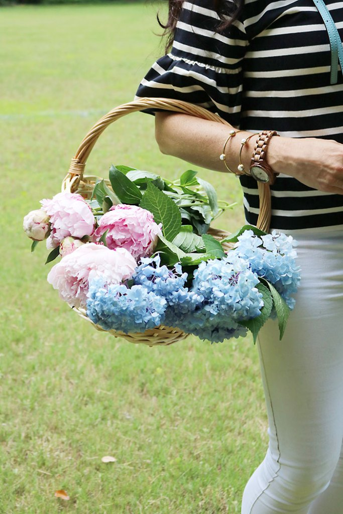 wooden-watch-holding-a-basket-of-flowers