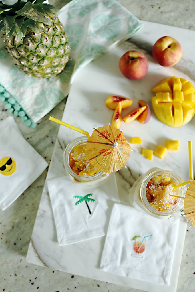 coconut-cream-smoothie-with-tropical-fruit, emoji cocktail napkin, mango, pineapple, peach, banana