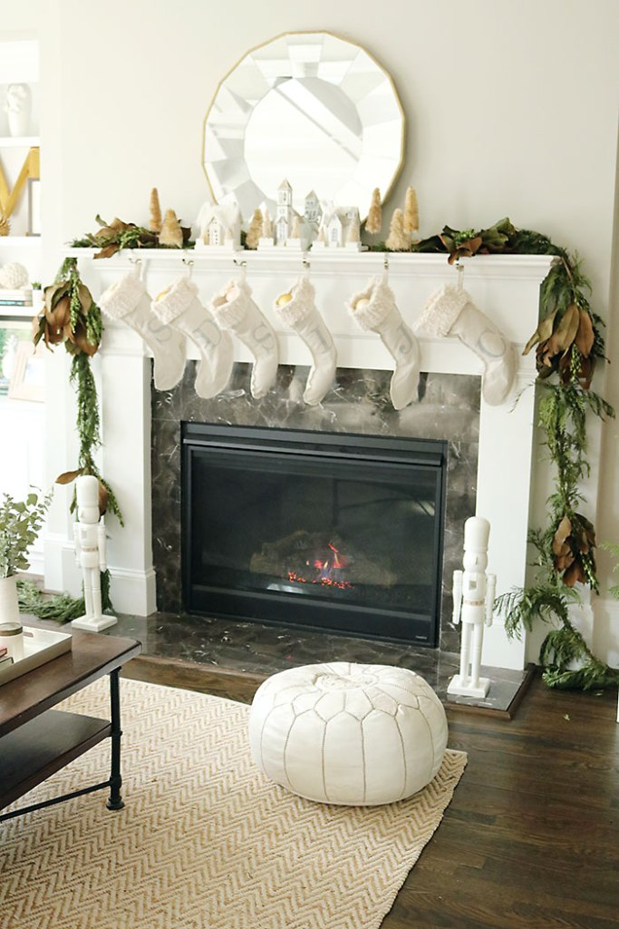 christmas-decorations-stocking-hung-by-chimney, christmas-decorations-living-room-shot, fireplace mantle christmas decorations, magnolia garland, winter white christmas, living room christmas decorations