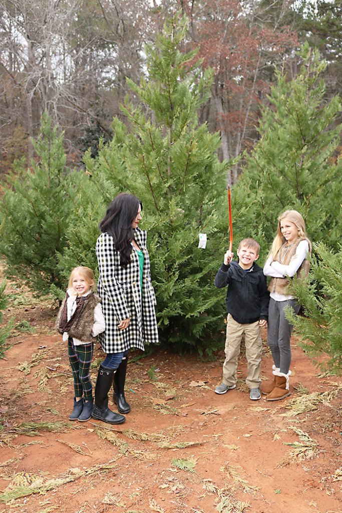 cutting-christmas-tree-down-with-saw