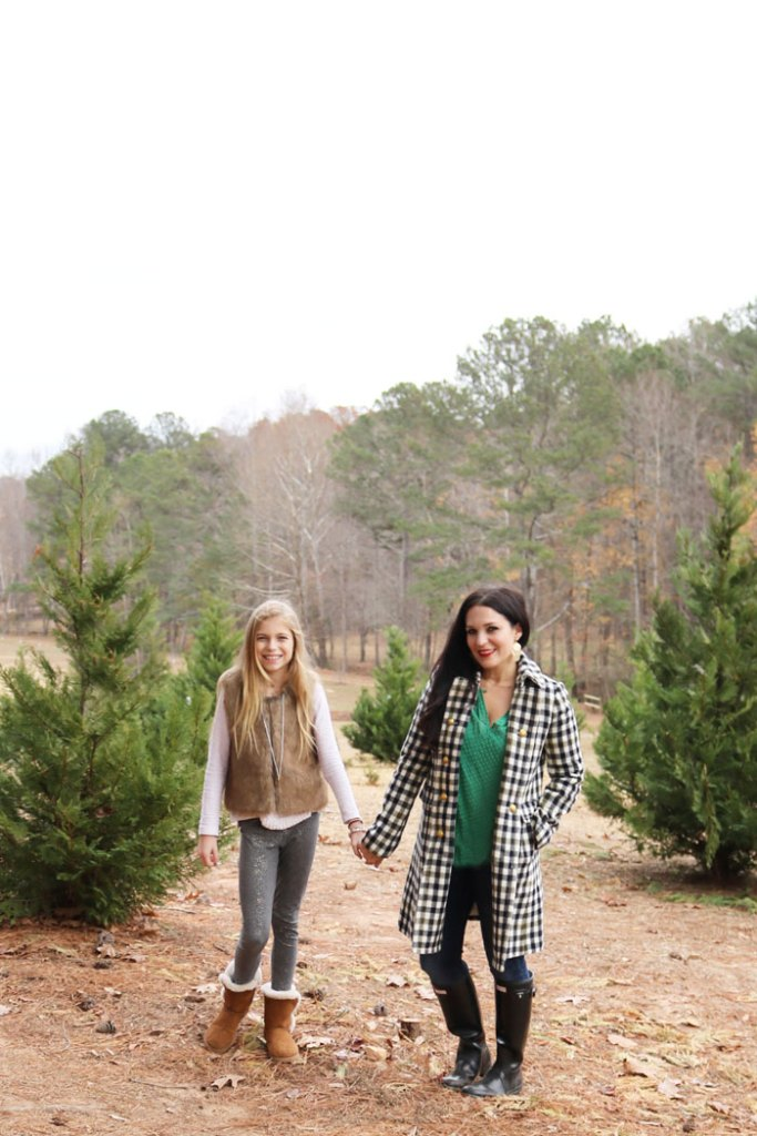 cutting-down-christmas-tree-mother-and-daugher