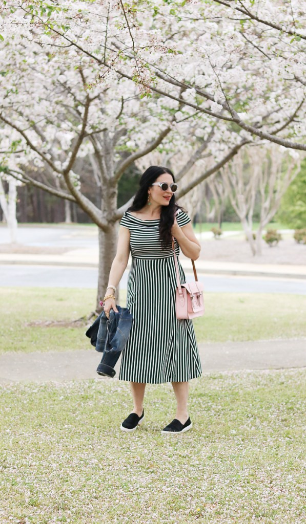 stylish ways to wear a dress with sneakers, sneaker dress outfit, casual black and white dress with sneakers, british made satchel tote, jean jacket, converse slip on sneakers, spring fashion casual outfit
