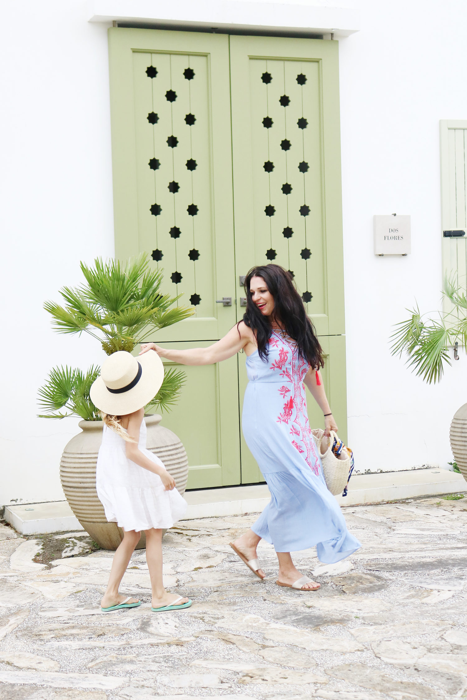 Walking around Alys Beach with daughter in hand in our beach vacation maxi dresses.  We love how beautiful this area of 30A florida   what maxi dress to pack for a beach trip    Darling Darleen