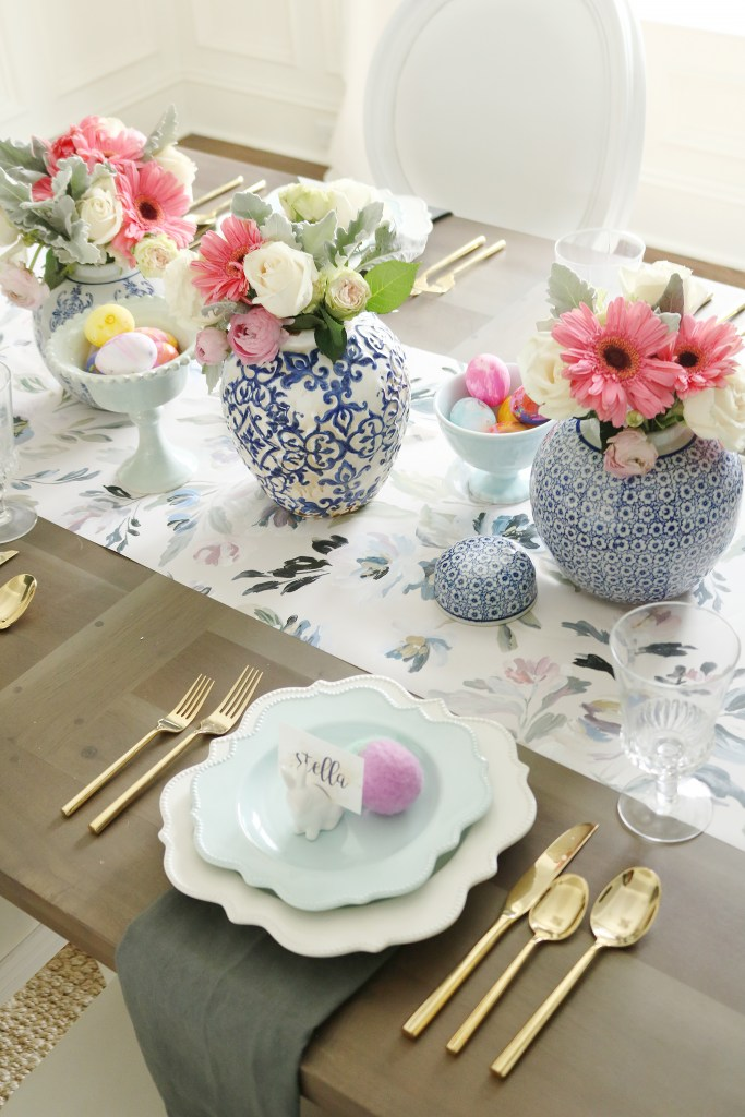 Easter table with blue and white ginger jars and spring flowers.  Easter eggs in fancy bowls || Darling Darleen #eastertable #gingerjars