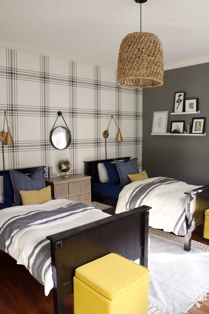 Bold Tween Boys Bedroom with Twin Beds and Plaid Wallpaper with Lamps Over Headboard and mirror.  Floating gallery wall and basket pendant light add texture to the bedroom || Darling Darleen