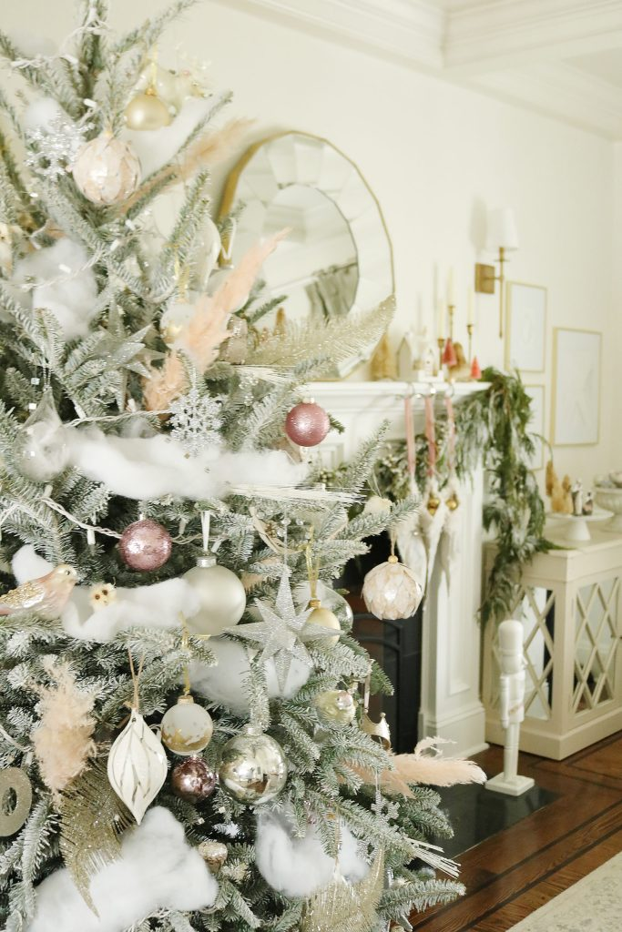 Blush Pink, Rose Gold Pink Christmas Tree and Decor for A Pink Christmas with a White Flocked Tree and garland over fireplace mantle.  Pink Ornaments and nutcracker.  Silver and gold metallic ornaments || Darling Darleen #darlingdarleen #pinkchristmas