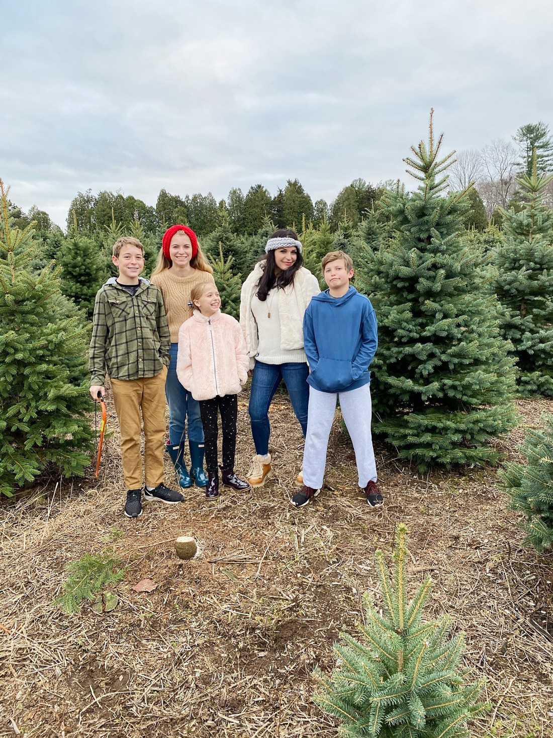 Our annual family tradition brings us to the Christmas Tree farm to find the perfect Christmas tree to cut down and bring home to decorate! Cutting down Christmas Tree.  Christmas tree cutting outfits || Darling Darleen Top Lifestyle Blogger