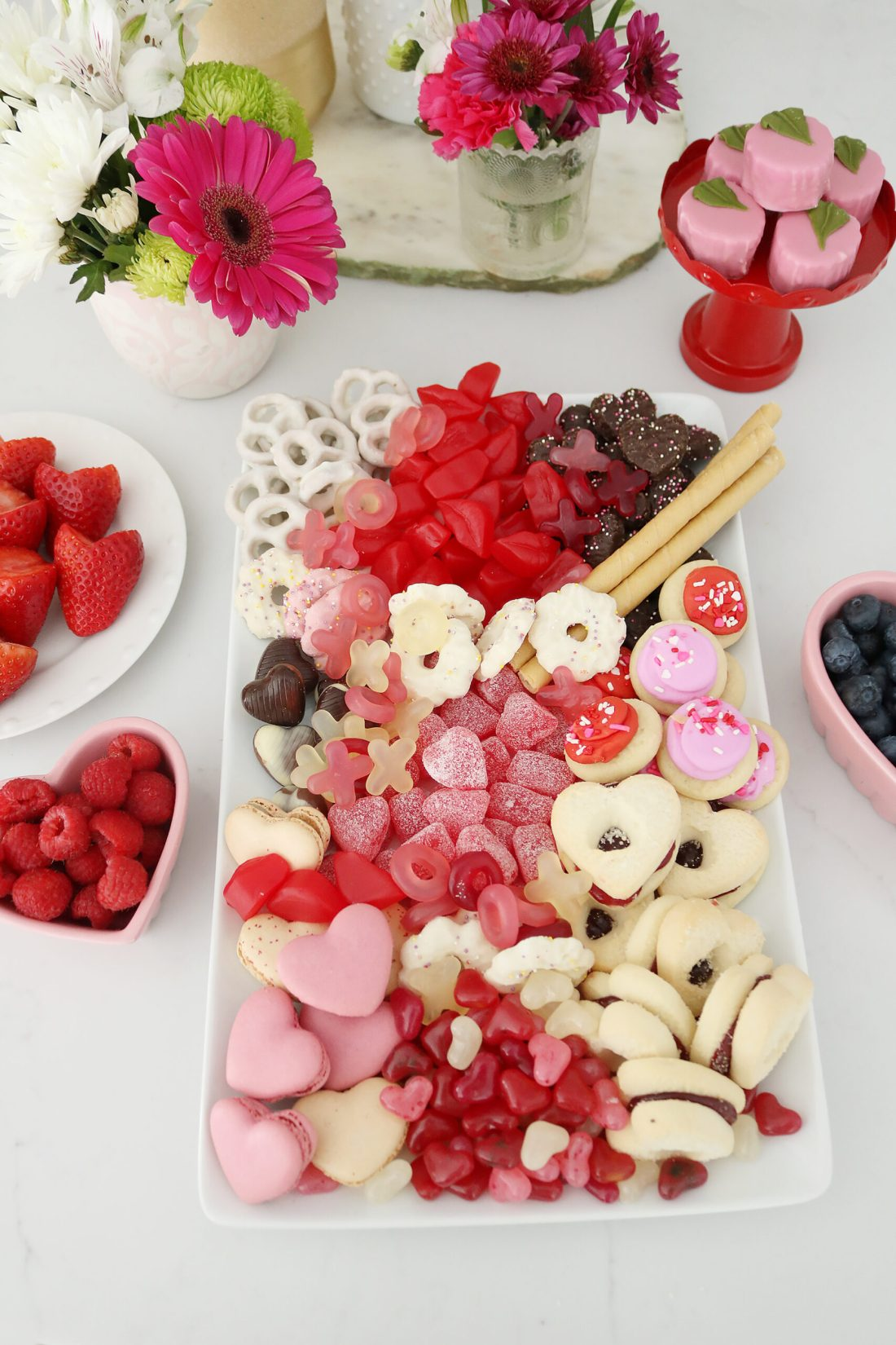 Bring Valentine's Day Home this year!  Put together a Valentine's charcuterie board with heart shaped chocolate, cinnamon lips and macrons!  So many fun Valentine's Day ideas to share with your family || Darling Darleen Top Lifestyle Blogger #ctblogger #darlingdarleen #valentinesday