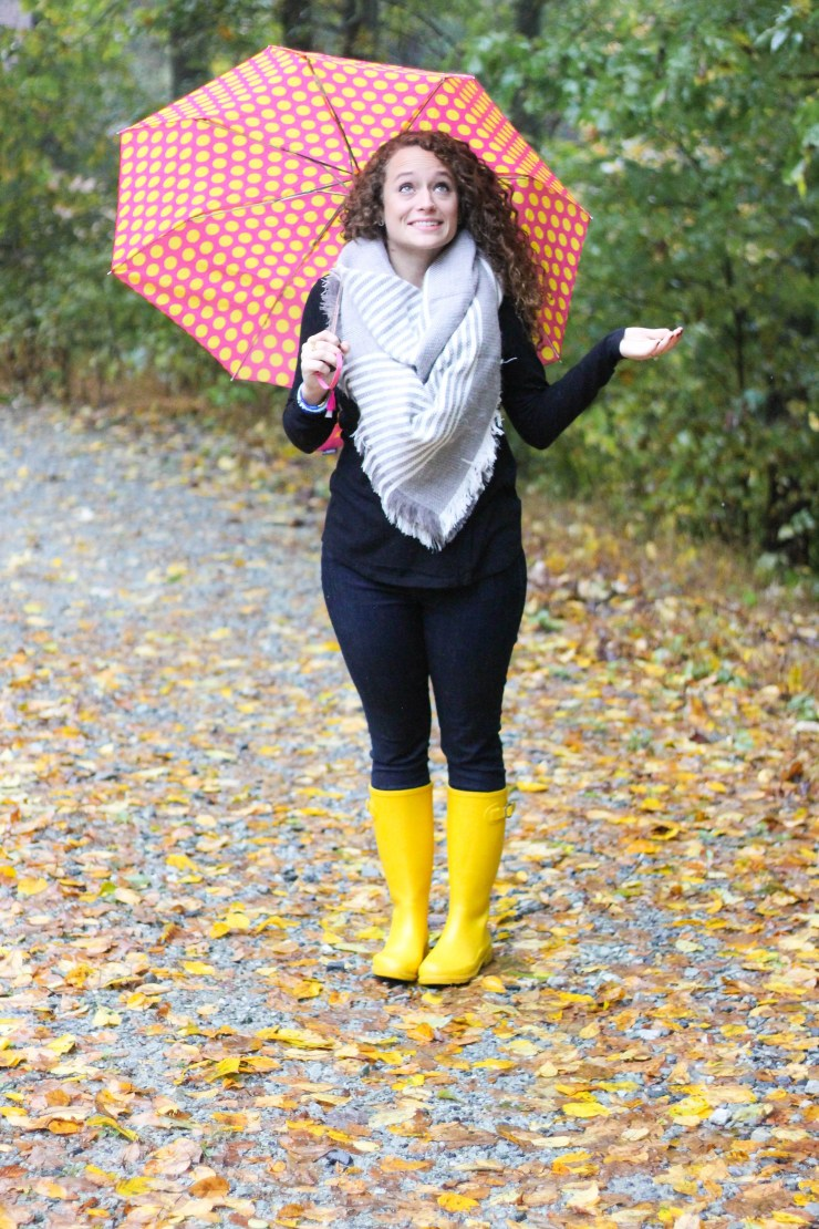 Yellow Rainboots, Skinny Jeans, Black Long Sleeve Tea, and Gray and White Blanket Scarf