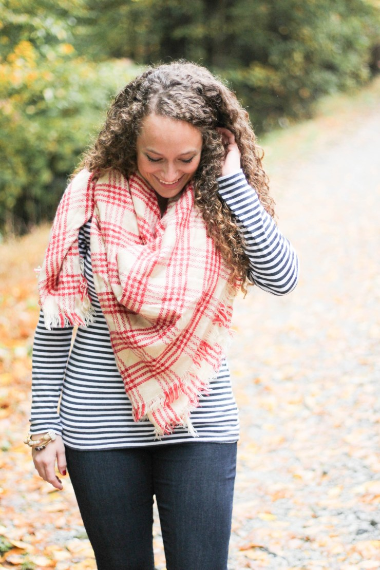red plaid blanket scarf, black and white striped shirt, black riding boots