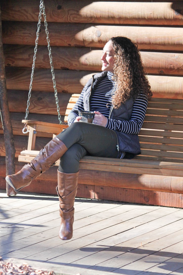 Striped turtleneck, gray vest, olive pants, and cognac boots