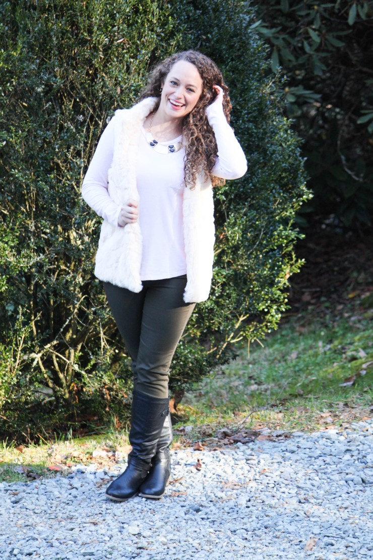 pink shirt, white fur vest, olive green pants and black boots