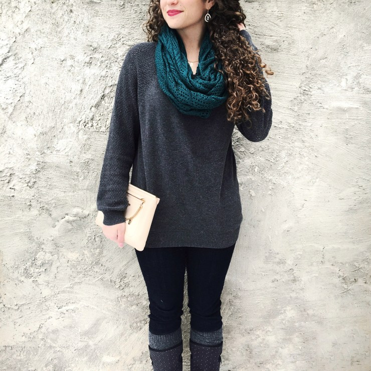 gray sweater and teal scarf