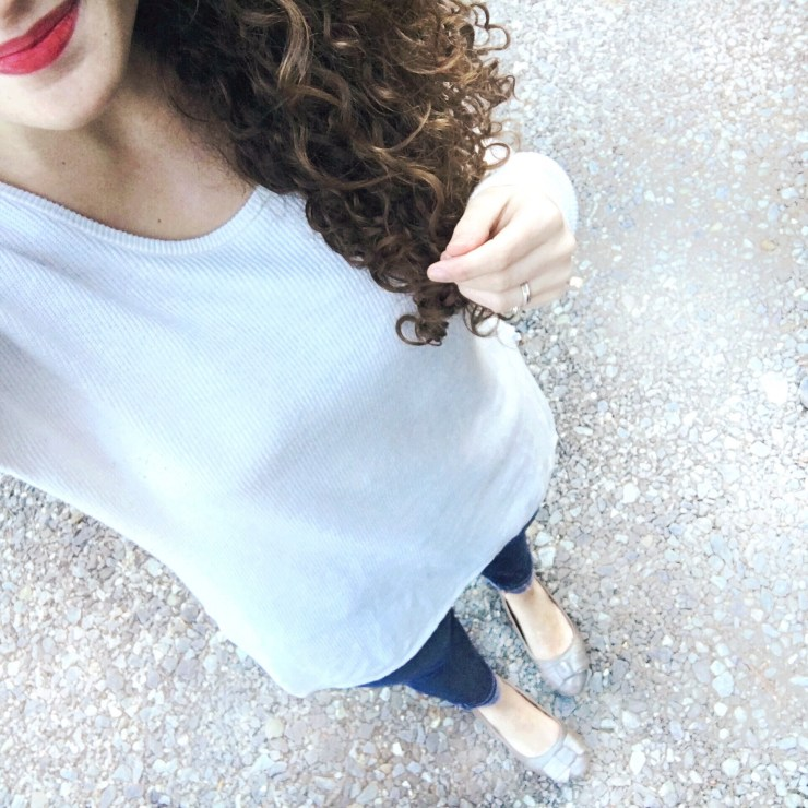 white sweater, red lips