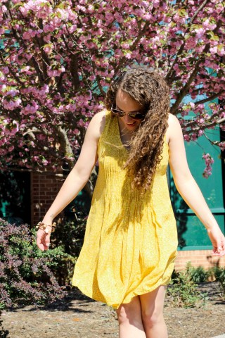 yellow summer dress with cowgirl boots