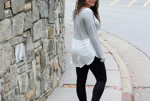 Sneakers, black skinny jeans, and a two tone top