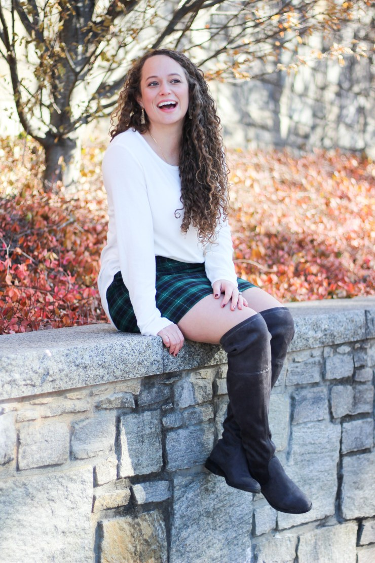 holiday plaid skirt with over the knee boots and a white sweater