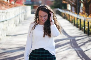 holiday plaid skirt with burgundy tights and a white sweater