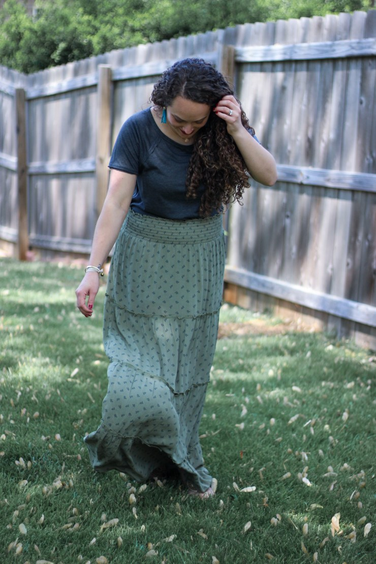 olive green maxi skirt for a neutral spring outfit with a cold shoulder top